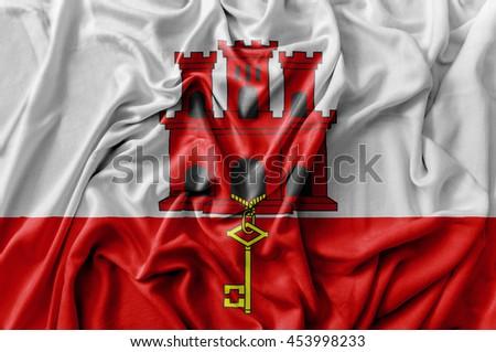 Ruffled waving Gibraltar flag - stock photo