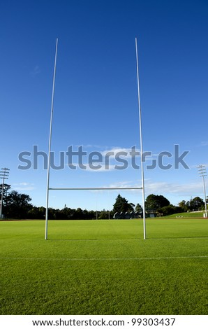 Rugby field and goalposts - stock photo