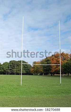 rugby goalposts in the park - stock photo