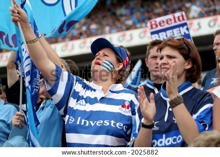 Rugby player fans - stock photo
