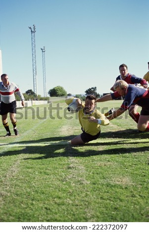 Rugby player scoring a try - stock photo
