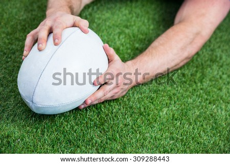 Rugby player scoring a try on astro turf grass - stock photo