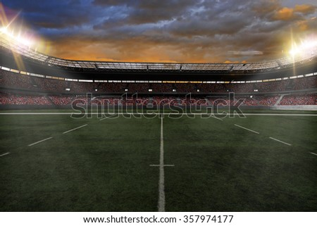 Rugby Stadium with fans wearing red uniforms - stock photo