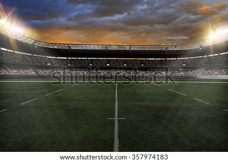 Rugby Stadium with fans wearing white uniforms - stock photo