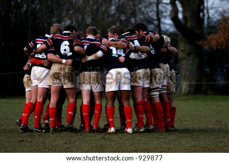 Rugby Team in a huddle - stock photo