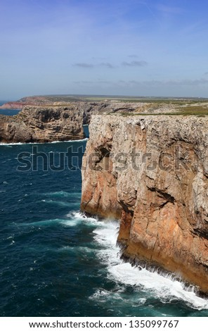 Rugged cliff line at Cape Saint Vincent - Sagres Portugal from the Lighthouse. This Cape is located at the furthest South West point on the Portuguese Coast. - stock photo