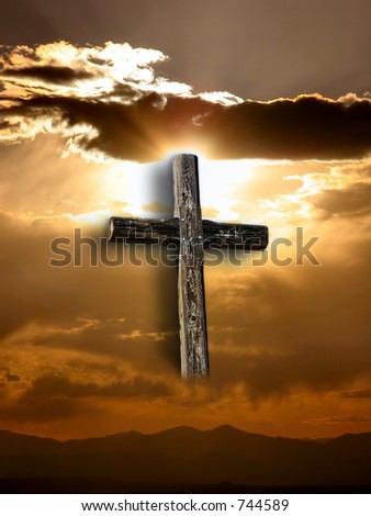 Rugged cross under a ray of sunshine through clouds. - stock photo
