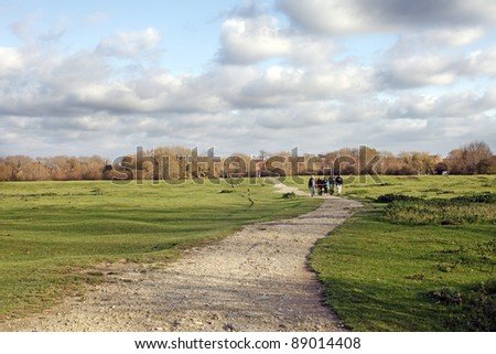 Rugged natural footpath through a outdoor park at the countryside of Binsey, Oxford, England against a dramatic cloudy sky. - stock photo