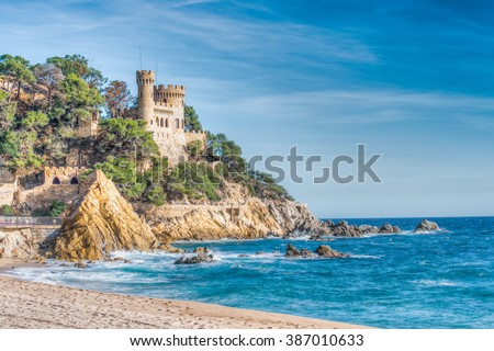 Rugged rocky coast, Lloret de Mar, Costa Brava, Catalonia, Spain - stock photo