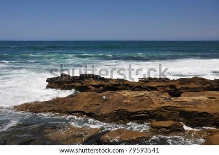 Rugged shoreline rocks create many tide pools along the southern coast of California. - stock photo