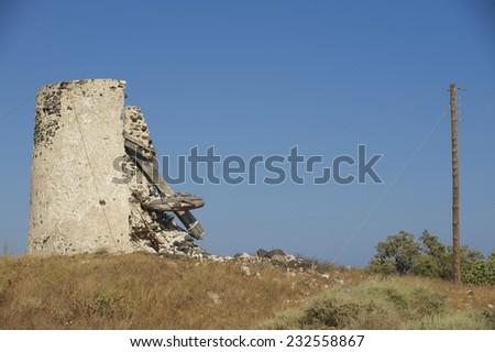 Ruin of ancient windmill at Santorini, Greece. - stock photo