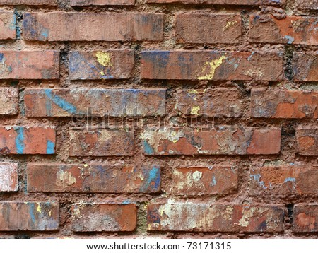 Ruined and colored brick wall - stock photo