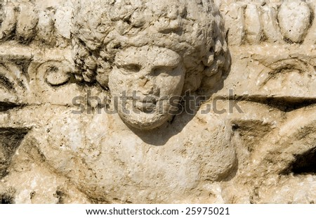 ruined bas-relief in ancient city of beit shean, israel - stock photo