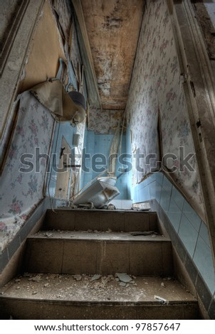 Ruined bathroom in an abandoned hotel - stock photo
