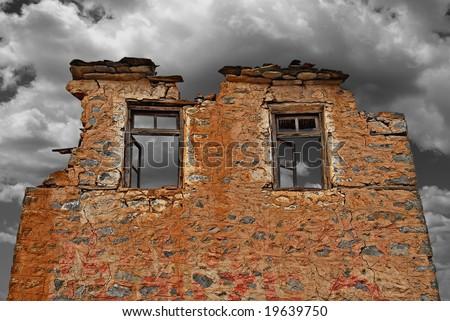 Ruined brick wall and windows - stock photo