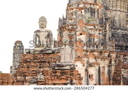 Ruined Budhas in thai pagoda background at Wat Chaiwattanaram Ayudhaya, Thailand - stock photo