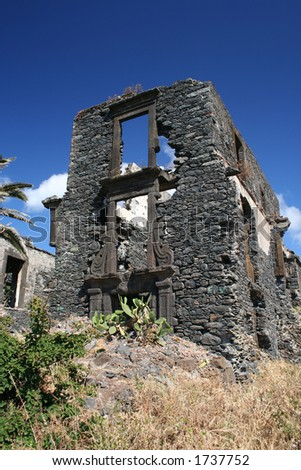 ruined building on the coast of Madeira, near Canico. Polarised blue sky - stock photo