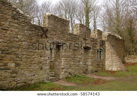 Ruined cottages The Rectory Cottages of the village of Tyneham in Dorset.  Abandoned during World War II when the Ministry of Defence took over the area as a firing range. - stock photo