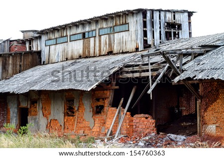 Ruined factory constructed of red bricks on crisis time - stock photo