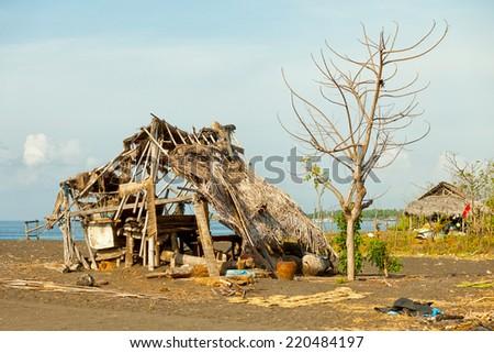 Ruined hut on the beach. Indonesia, Bali island - stock photo