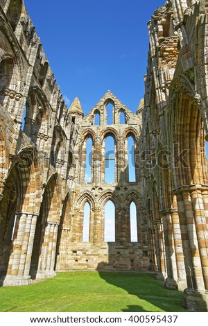 Ruined inner walls to Whitby Abbey in North Yorkshire in England. It is ruins of the Benedictine abbey. Now it is under protection of the English Heritage. - stock photo