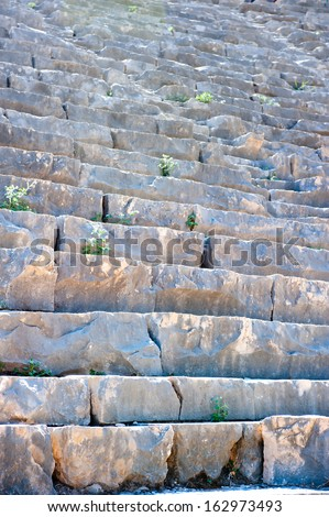 ruined stone steps of the ancient Roman theater - stock photo