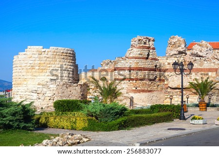 Ruined tower and stone walls around the old Nessebar town, Bulgaria - stock photo