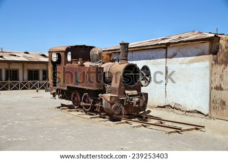 Ruined train in deserted ghost town of Humberstone near Iquique, Chile - stock photo
