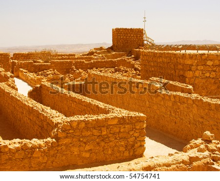 Ruins at Masada with Dead Sea in background - stock photo
