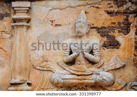 Ruins Buddha image, pagoda, monastery in ancient temple, Chiengmai province northern of Thailand. - stock photo