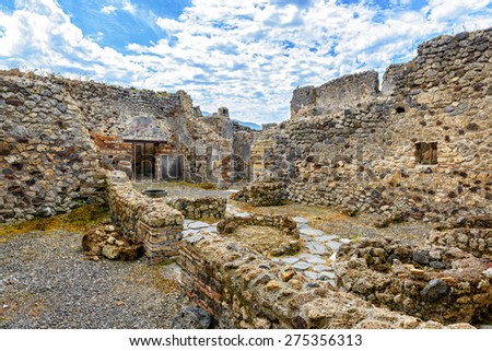Ruins of a house in Pompeii, Italy. Pompeii is an ancient Roman city died from the eruption of Mount Vesuvius in 79 AD. - stock photo