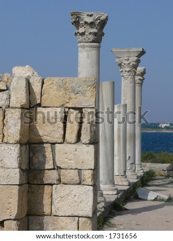 Ruins of a temple on seacoast - stock photo