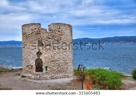 Ruins of an ancient fortress watchtower in Nessebar, Bulgaria. UNESCO World Heritage Site on a cloudy weather with the black sea background - stock photo