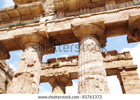 Ruins of an ancient greek temple in Paestum, Italy. - stock photo