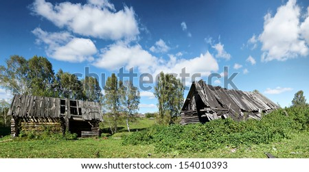 Ruins of an old wooden house in Russian village - stock photo