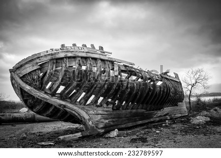 Ruins of an old wooden ship in Black and White - stock photo