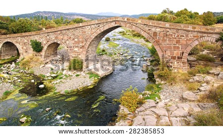 Ruins of ancient bridge in Assos in Turkey.                                - stock photo