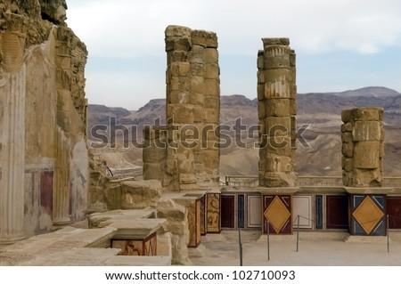 Ruins of ancient colonnade of King Herod's palace in Masada, Dead Sea, Israel - stock photo