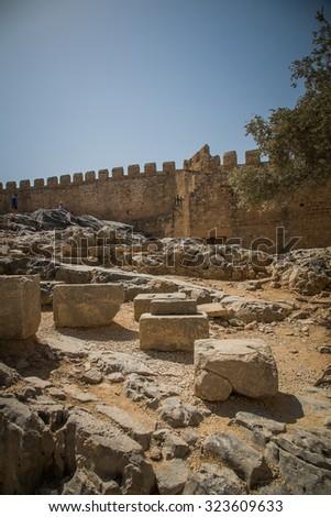 Ruins of ancient Doric temple of Athena Lindia, Lindos, Rhodes island, Greece - stock photo