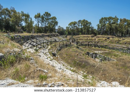 Ruins of ancient Roman ampheteater in Syracuse, Sicily - stock photo