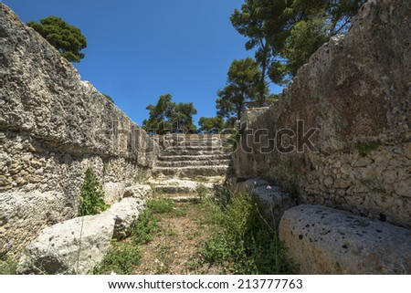 Ruins of ancient Roman amphitheater in Syracuse, Sicily - stock photo