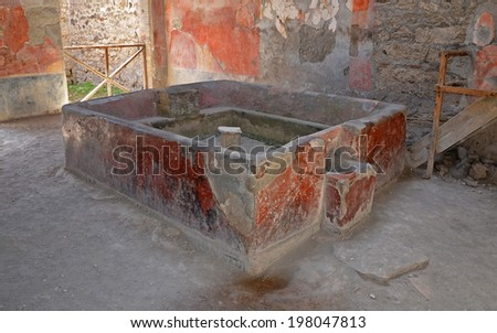 Ruins of ancient Roman city of Pompeii. Laundry of Stephanus. A vat for washing. - stock photo
