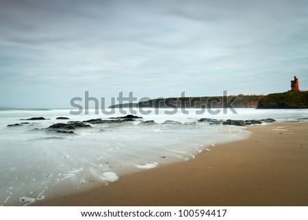 Ruins of Ballybunion castle at the ocean, Ireland - stock photo
