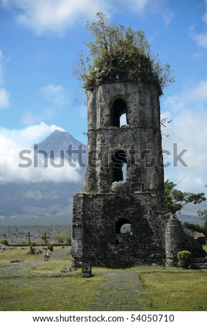 ruins of cagsawa church and mayon volcano in albay province south luzon in the philippines - stock photo