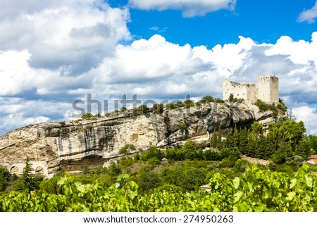 ruins of castle in Vaison-la-Romaine with vineyard, Provence, France - stock photo
