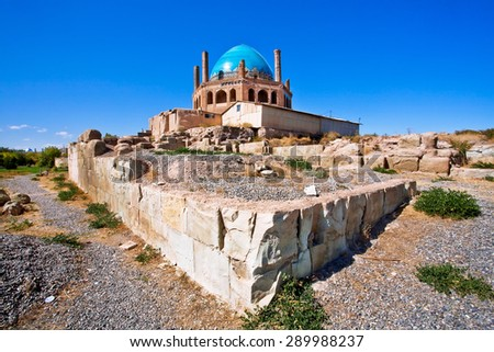 Ruins of historical wall around 14th century mausoleum Dome of Soltaniyeh near Zanjan city, Iran. UNESCO World Heritage Site, anticipating the Taj Mahal, erected from 1302 to 1312 AD.  - stock photo