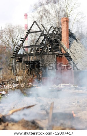 Ruins of house after big disaster - fire - stock photo