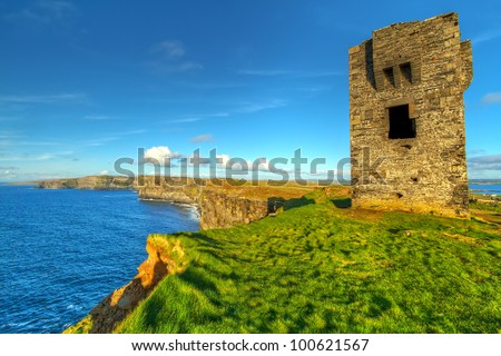Ruins of old castle on Cliffs of Moher, Ireland - stock photo