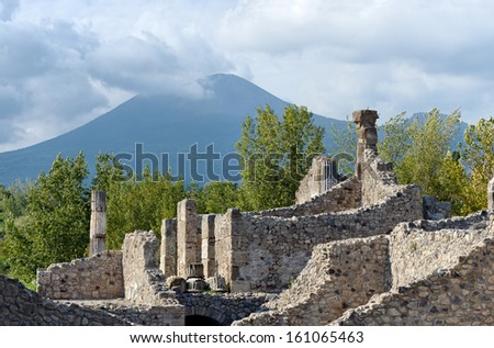 Ruins of Pompeii (Italy). UNESCO World Heritage Site with the volcano Mount Vesuvius that buried the city on 79 AD - stock photo