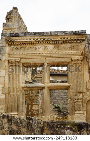 """Ruins of Renaissance building with inscription in Latin of  famous Calvinist saying: """"Post Tenebras Lux"""" (""""After the Darkness, Light"""") in Les Baux de Provence village (Provence, France). - stock photo"""